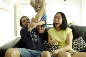 Parents playing with a child for positive reinforcement.