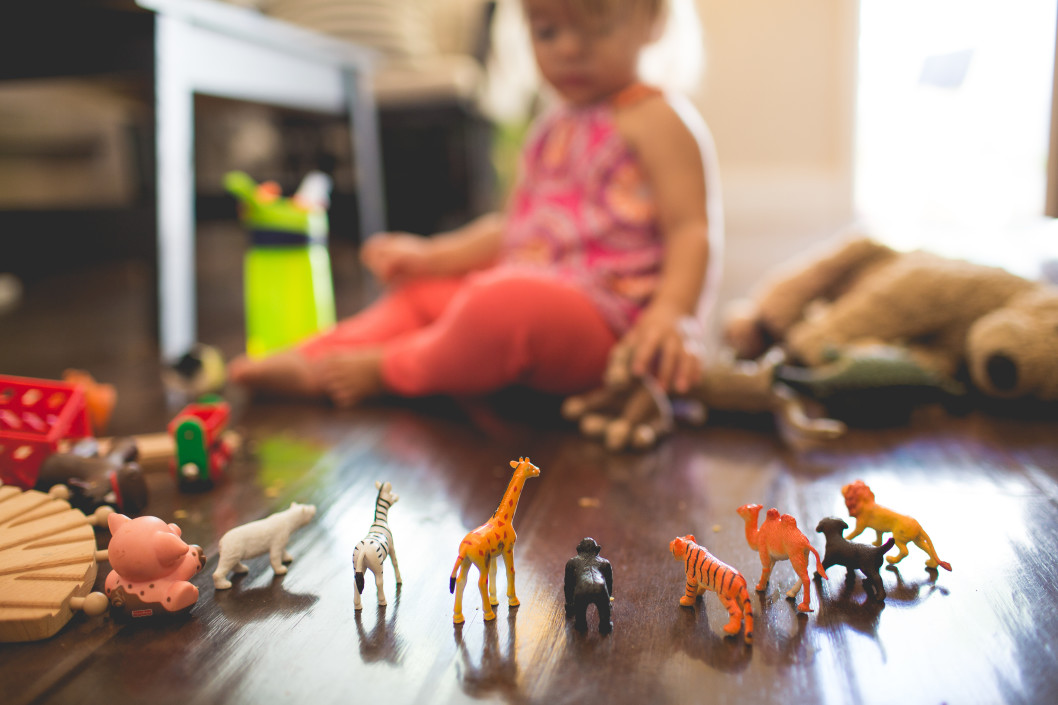 Child playing with animal figures