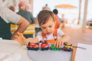 Child playing with toy train