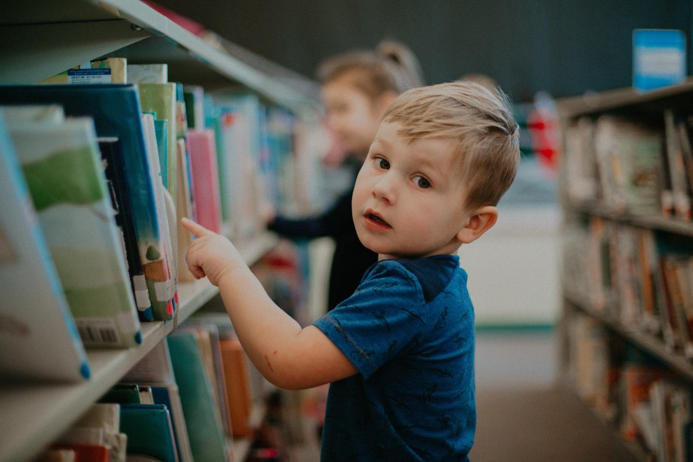 Child choosing a library book