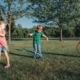 Children hula hooping in a park.